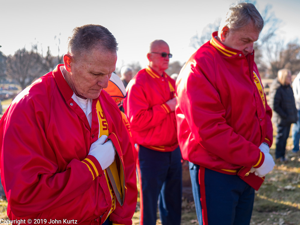 22 NOVEMBER 2019 - DES MOINES, IOWA: US Marine Corps veterans bow their heads during the reinterment service of US Marine Corps Reserve Private Channing Whitaker in Glendale Cemetery. Whitaker died in the Battle of Tarawa on Nov. 22, 1943. He was buried on Betio Island, in the Gilbert Islands, and his remains were recovered in March 2019. He was identified by a DNA match with surviving family members in Iowa. Whitaker was reintered in the Glendale Cemetery in Des Moines exactly 76 years after his death in World War Two. About 1,000 US Marines and sailers were killed in four days during the Battle of Tarawa.            PHOTO BY JACK KURTZ