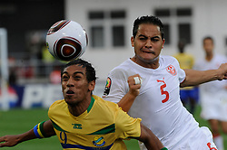 Gabon's Pierre Aubameyang battles Tunisia's Ammar Jemal during the African Soccer Cup of Nations Soccer match, Group D, Gabon vs Tunisia in Lubango, Angola on January 17, 2010. The match ended in a 0-0 draw. Photo by RainbowPress  (Credit Image: RealTime Images)