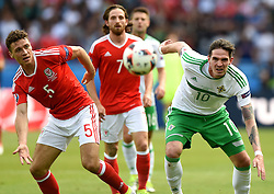 Kyle Lafferty of Northern Ireland battles for the high ball with,  James Chester of Wales  - Mandatory by-line: Joe Meredith/JMP - 25/06/2016 - FOOTBALL - Parc des Princes - Paris, France - Wales v Northern Ireland - UEFA European Championship Round of 16