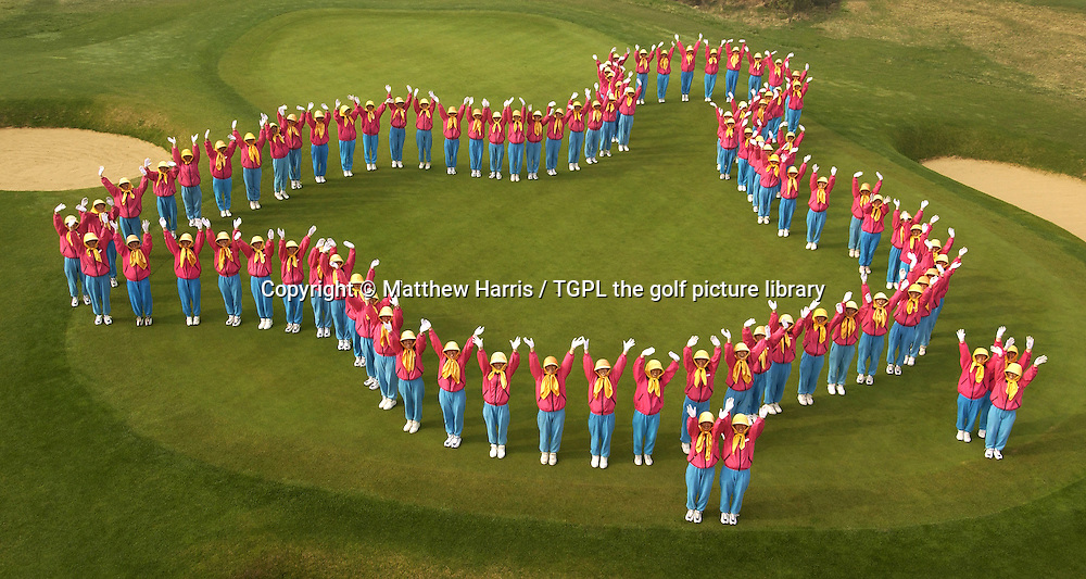 TIGER BEACH GOLF LINKS-Province-CHINA  27.4.05<br /> 90 caddies from the Tiger Beach Golf Links create the shape of their country China on the 1st green.