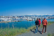 Visitors to Alaska check out the Homer Spit boat harbor