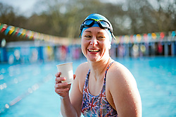©  London News Pictures. 26/01/2013. London, UK. A competitor in the Cold Water Swimming Championships at Tooting Bec Lido in South London enjoying a hot drink following a race on January 26, 2013. The biannual event sees some competitors dress in costume. Photo credit: Ben Cawthra/LNP
