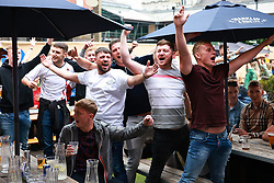 © Licensed to London News Pictures . 18/06/2021. Manchester, UK. Fans watch the match on screens at Impossible Bar in Manchester City Centre . Football fans watch the European Cup tie between England and Scotland at Wembley Stadium via screens in pubs and venues around Manchester City Centre . Photo credit: Joel Goodman/LNP