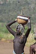 Africa, Ethiopia, Debub Omo Zone, woman of the Mursi tribe. A nomadic cattle herder ethnic group located in Southern Ethiopia, close to the Sudanese border. Mursi Woman