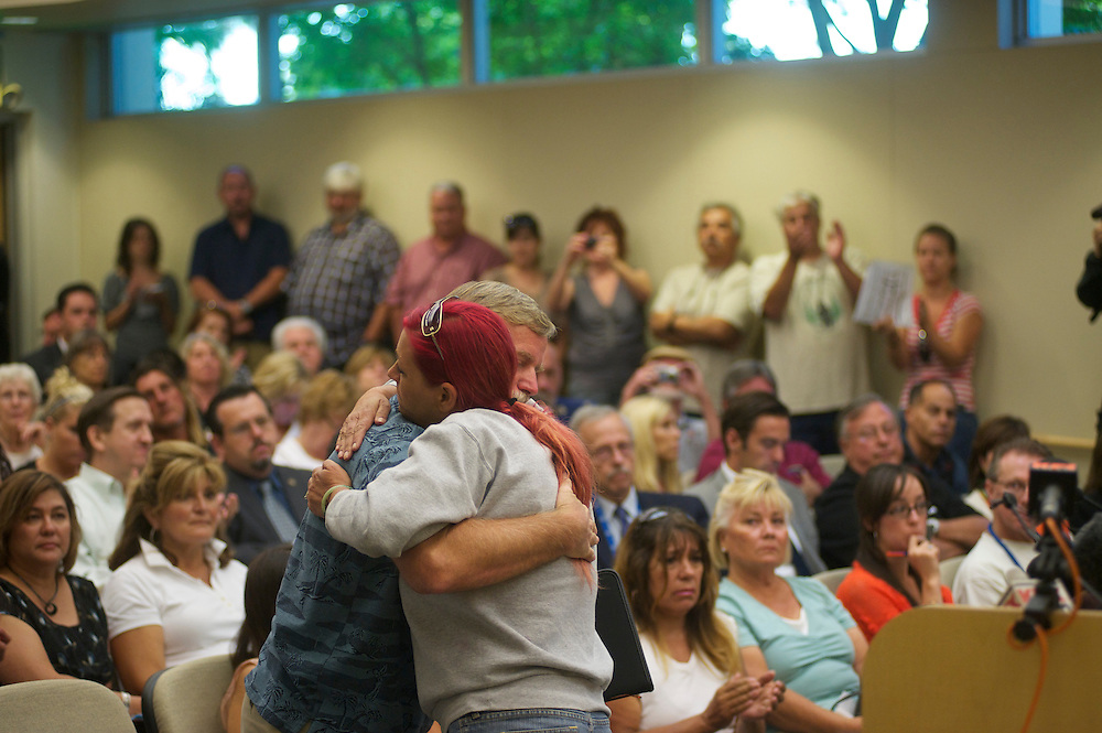 Michelle Kearney hugs Ron THomas. at a Fullerton City Council Meeting where public comments dominated the session.  Discussed was the death of Kelly Thomas, a mentally ill homeless man that died after an altercation with Fullerton Police. During the months since, two FPD officers have been charged with 2nd dgree murder and involuntary manslaughter and ar ecall campaign has begun agains three seated council members.