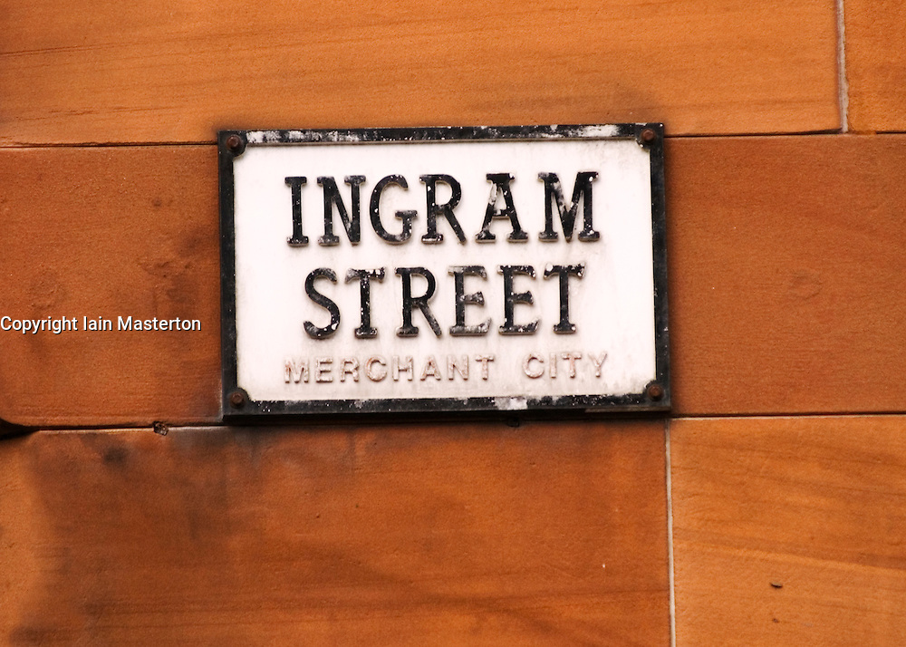 Detail of street sign on red stone  building wall in historic Merchant City district of Glasgow Scotland