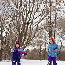 Two girls (age 6) snowshoeing at Odiorne Point State Park in Rye, New Hampshire.