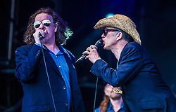 """Jake Black and Rob Spragg of Alabama 3 play the main stage. Sunday, Rockness 2013, the annual music festival which took place in Scotland at Clune Farm, Dores, on the banks of Loch Ness, near Inverness in the Scottish Highlands. The festival is known as """"the most beautiful festival in the world""""."""