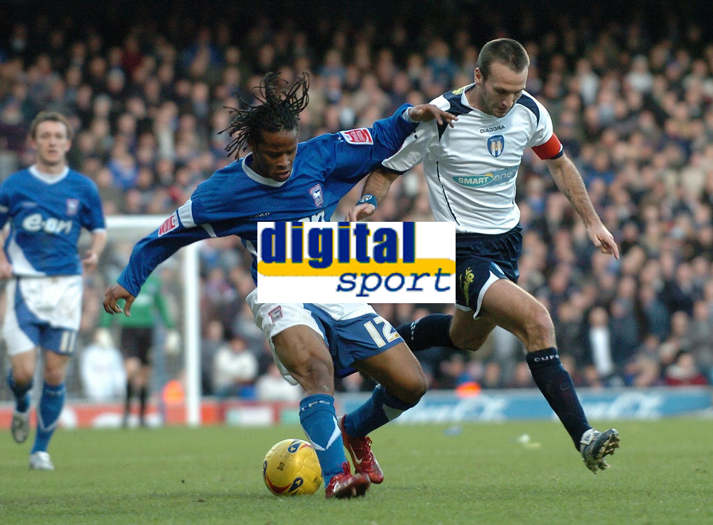 Photo: Ashley Pickering.<br />Ipswich Town v Colchester United. Coca Cola Championship. 20/01/2007.<br />Ipswich's Jaime Peters (L) holds off Colchester captain Karl Duguid
