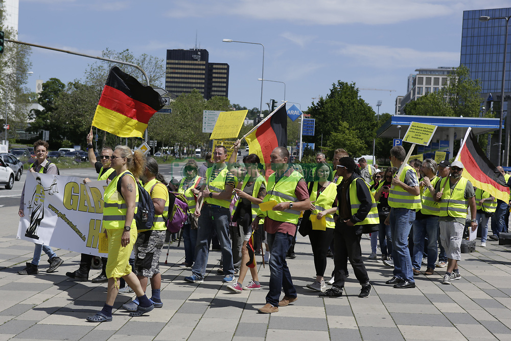 May 25, 2019 - Wiesbaden, Hesse, Germany - The protesters march with yellow vests through Wiesbaden. Under 100 right wing protesters marched with yellow vests through Wiesbaden, to protest against the German government. They were confronted by small but loud counter protest. (Credit Image: © Michael Debets/Pacific Press via ZUMA Wire)