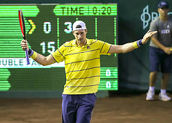 April 13, 2018 - Houston, TX, U.S. - HOUSTON, TX - APRIL 13:  John Isner of the United States throws his hands in exasperation after missing a point in the match against Steve Johnson of the United States during the Quarterfinal round of the Men's Clay Court Championship on April 13, 2018 at River Oaks Country Club in Houston, Texas.  (Photo by Leslie Plaza Johnson/Icon Sportswire) (Credit Image: © Leslie Plaza Johnson/Icon SMI via ZUMA Press)