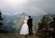 Newlyweds, Don and Susan Nord, from Michigan, watch a rainbow at Glacier Point in Yosemite National Park,September 17, 1993.  The ceremony was performed by the Hon. Judge Don Pitts, ret. who was the Federal Magistrate in the park.