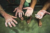 Palmer Larsen's and Gabriel Patterson's hands, Millcreek Momentum Climbing Gym, Salt Lake City, Utah.