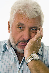 Mature man looking bored,