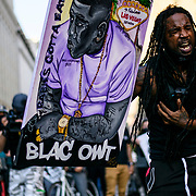 A protester recites a poem to other Black Lives Matter protesters near lafayette park. The protesters gathered to defy the curfew and protest the killing of George Floyd in Minneapolis.