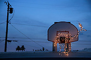 Christmas deer animal decoration in a basketball hoop Palm Springs CA USA at sunset
