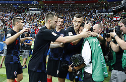 MOSCOW, July 11, 2018  Croatia's players comfort a photographer after he was knocked down during the 2018 FIFA World Cup semi-final match between England and Croatia in Moscow, Russia, July 11, 2018. Croatia won 2-1 and advanced to the final. (Credit Image: © Cao Can/Xinhua via ZUMA Wire)