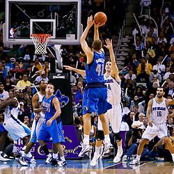 November 17, 2010; New Orleans, LA, USA; Dallas Mavericks power forward Dirk Nowitzki (41) of Germany shoots over New Orleans Hornets power forward Jason Smith (14) during a game at the New Orleans Arena. The Hornets defeated the Mavericks 99-97. Mandatory Credit: Derick E. Hingle