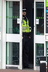 March 27, 2019 - Leeds, Yorkshire, UK - Leeds, UK. Police on the scene at the Killingbeck ASDA shop on York road in Leeds this morning where it is believed a man walked in the shop & stabbed himself, Police where called to the shop at 5:57am this morning where a man was found with serious injuries & was taken to hospital. Police have said they are satisfied this has been a self-harm incident with no other person involved & there are no suspicious circumstances. (Credit Image: © Andrew Mccaren/London News Pictures via ZUMA Wire)