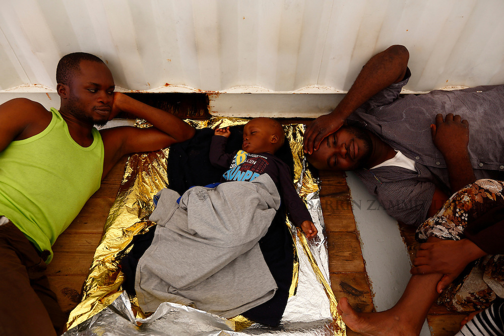 A migrant baby sleeps on the deck of the Medecins san Frontiere (MSF) rescue ship Bourbon Argos somewhere between Libya and Sicily August 8, 2015.  Some 241 mostly West African migrants on the ship are expected to arrive on the Italian island of Sicily on Sunday morning, according to MSF.<br /> REUTERS/Darrin Zammit Lupi <br /> MALTA OUT. NO COMMERCIAL OR EDITORIAL SALES IN MALTA