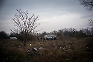 A group of independed volunteers offering some food to the migrants in a makeshift camp in the woods not far form the town of Subotica, about 10 Km from the Hungarian border. Hundreds of migrants are living in the woods waiting to cross the border. Subotica, Serbia. March 18th, 2017. Federico Scoppa