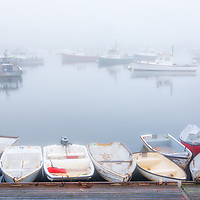 Picturesque New England harbor fog photography of Green Harbor in Marshfield, Massachusetts. The fog beautifully created a serene harbor scenery.<br />