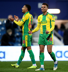 West Bromwich Albion's Jacob Murphy (right) and Mason Holgate celebrate at the final whistle during the Sky Bet Championship match at Loftus Road, London.