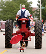 Muppet rides in a small wagon being pulled by an antique tractor driven by Dave Weidner, during the 2006 Schaumburg Septemberfest parade.<br /> Daily Herald photo by Mark Black