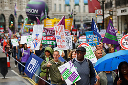 © Licensed to London News Pictures. 10/07/2014. LONDON, UK. Public sector workers marching from BBC Broadcasting House to Trafalgar Square in central London to protest in a series of disputes with the government over pay, pensions and cuts, with more than a million public sector workers expected to join the action across the UK. Photo credit : Tolga Akmen/LNP