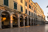 Early morning light on the arcades of the Liston in Corfu Old Town, Corfu, The Ionian Islands, The Greek Islands, Greece, Europe