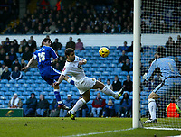 Photo: Andrew Unwin.<br />Leeds United v Cardiff City. Coca Cola Championship.<br />10/12/2005.<br />Cardiff's Joe Ledley (L) gets in an early shot on goal.