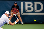 USA's John Isner reaches for a return against India's Somdev Dewarman during their men's singles match at the Citi Open ATP tennis tournament in Washington, DC, USA, 1 Aug 2013. Isner won the match 7-5, 7-5 to advance.