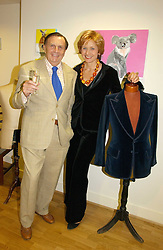 BARRY & LIZZY HUMPHRIES at an exhibition of art by Oscar Humphries entitles 'Post-Nuclear Family' held at Nutters, Lower Ground, 12 Savile Row, London on 8th June 2006.<br /><br />NON EXCLUSIVE - WORLD RIGHTS