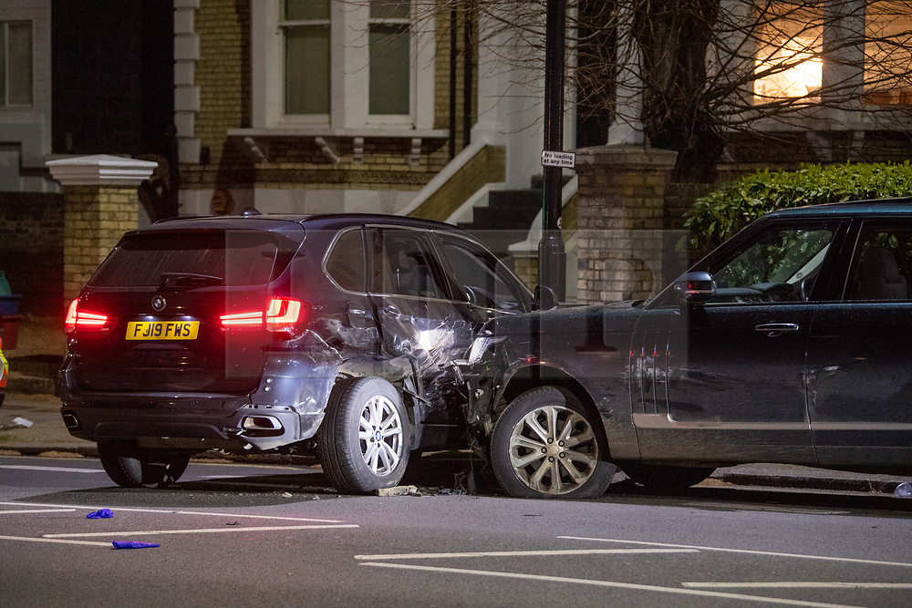 © Licensed to London News Pictures. 08/04/2021. London, UK. A police vehicle (L) and the offenders vehicle (R) on Chiswick High Road following a incident in which a vehicle was stopped by armed police at approximately 22:30hrs on Wednesday 07/04/2021 when police approached the vehicle, officers discovered the lone male occupant had sustained a number of serious self-inflicted injuries. First aid was commenced immediately and the London Ambulance Service were called. The male has been taken to a west London hospital. Photo credit: Peter Manning/LNP