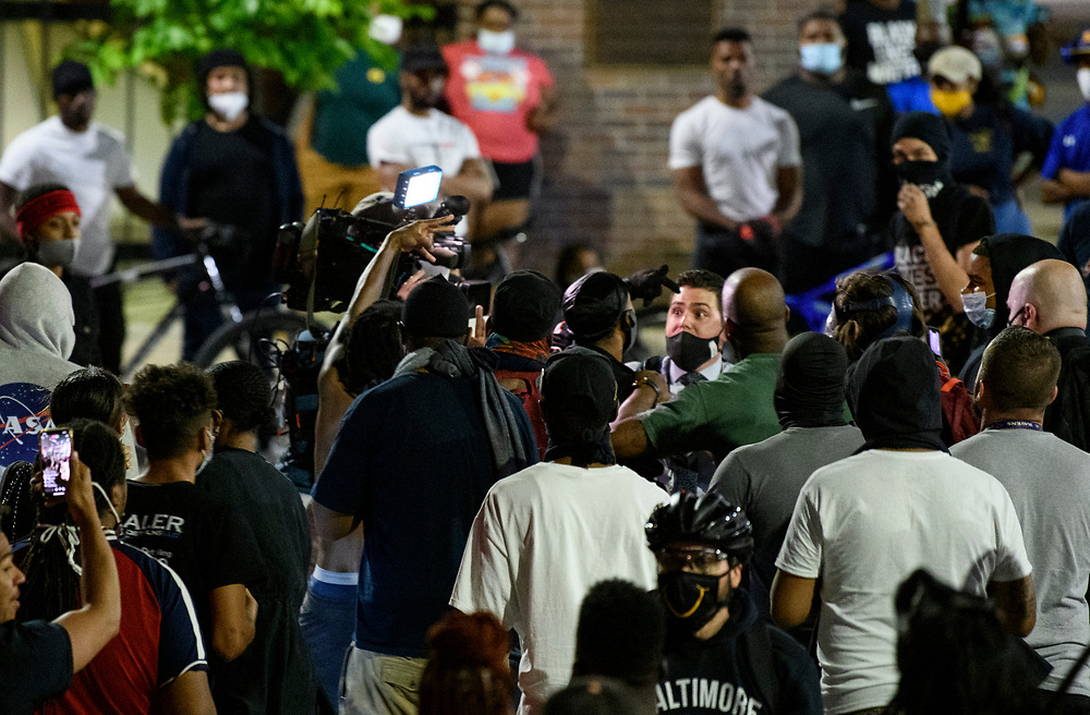 A news crew is forced out of the area by protestors. Protests in Baltimore carry into the night, with many at City Hall. In cities across the United States, people protested in the streets for the fourth day and night in protest of the death of George Floyd in Minneapolis police custody.