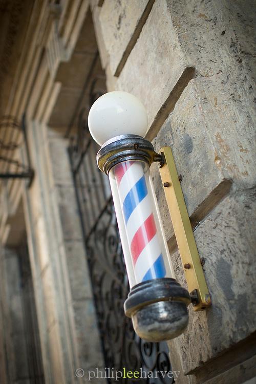 Close up of hair dresser sign on building exterior, Havana, Cuba
