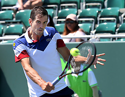 March 22, 2018 - Key Biscayne, FL, USA - Guillermo Garcia-Lopez of Spain returns against Tennys Sandgren of the United States in the first round of the Miami Open in Key Biscayne, Fla., on Thursday, March 22, 2018. (Credit Image: © Pedro Portal/TNS via ZUMA Wire)