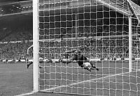 Football<br /> Jim Montgomery (Sunderland goalkeeper) makes a spectacular save from Peter Lorimer (ground). <br /> Sunderland v Leeds United. FA Cup Final 1973. <br /> 05/05/1973. <br /> Credit : Colorsport.