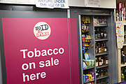 Sliding door covering tobacco on sale at a small corner shop in London, UK. In early 2015 the new laws came in that made all small shop oweners have to cover up cigarettes and other smoking products as part of a health initiative.