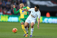 Neil Taylor of Swansea city is tackled by Nathan Redmond (l) of Norwich city.Barclays Premier league match, Swansea city v Norwich city at the Liberty Stadium in Swansea, South Wales  on Saturday 5th March 2016.<br /> pic by  Andrew Orchard, Andrew Orchard sports photography.
