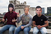 Tourists at the Tower of London wear celebrity and royal face masks. Jessie J, Her Majesty Queen Elizabeth II and Rowan Atkinson. This type of mask has become very popular as a joke during public events and in tourists shops.