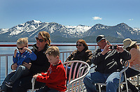 Passengers aboard MS Dixie II, paddle steamer, moored, Zephyr Cove, Nevada, USA, is the largest vessel on South Lake Tahoe. The lake itself is split vertically between Nevada in the East and California in the West. It traverses the lake from Zephyr Cove to Emerald Bay in California. 201304261898<br /> <br /> Copyright Image from Victor Patterson, 54 Dorchester Park, Belfast, UK, BT9 6RJ<br /> <br /> Tel: +44 28 9066 1296<br /> Mob: +44 7802 353836<br /> Voicemail +44 20 8816 7153<br /> Skype: victorpattersonbelfast<br /> Email: victorpatterson@me.com<br /> Email: victorpatterson@ireland.com (back-up)<br /> <br /> IMPORTANT: If you wish to use this image or any other of my images please go to www.victorpatterson.com and click on the Terms & Conditions. Then contact me by email or phone with the reference number(s) of the image(s) concerned.