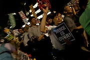 Protestors hold signs and banners calingl for the abolition of nuclear power in the weekly Friday night protests outside the Prime Minister's office and national diet building in Tokyo, Japan.Friday September 7th 2012