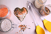 Red white, and black lentils forming a valentine heart shape for healthy living