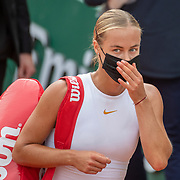 PARIS, FRANCE September 30. Anna Karolina Schmiedlov of Slovakia leaves the court wearing a mask after her victory against Victoria Azarenka of Belarus in the second round of the singles competition on Court Simonne Mathieu during the French Open Tennis Tournament at Roland Garros on September 30th 2020 in Paris, France. (Photo by Tim Clayton/Corbis via Getty Images)