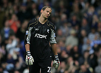 Photo: Lee Earle.<br /> Portsmouth v Bolton Wanderers. The FA Barclays Premiership. 18/08/2007.Bolton keeper Jussi Jaaskelainen looks dejected after Portsmouth scored their second goal.