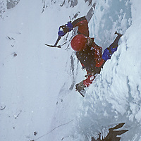ICE CLIMBING. Bill McConachie on steep ice in Lee Vining Canyon, east of Yosemite in CA's Sierra Nevada.