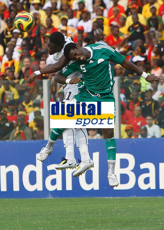 Photo: Steve Bond/Richard Lane Photography.<br />Ghana v Nigeria. Africa Cup of Nations. 03/02/2008. Obinna Nwaneri (R) and Sulley Muntari (L) challange in the air