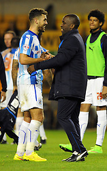 Huddersfield Town's Tommy Smith shares a joke with Huddersfield Town Manager, Chris Powell at the end of the game - Photo mandatory by-line: Dougie Allward/JMP - Mobile: 07966 386802 - 01/10/2014 - SPORT - Football - Wolverhampton - Molineux Stadium - Wolverhampton Wonderers v Huddersfield Town - Sky Bet Championship