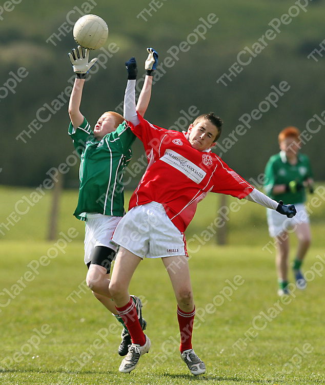 Kilrush's Conor Bolton and Eire Og's Evan Twomey contest a high ball during their Feile Final clash in Coolmeen on Sunday afternoon.<br /> Photograph by Yvonne Vaughan